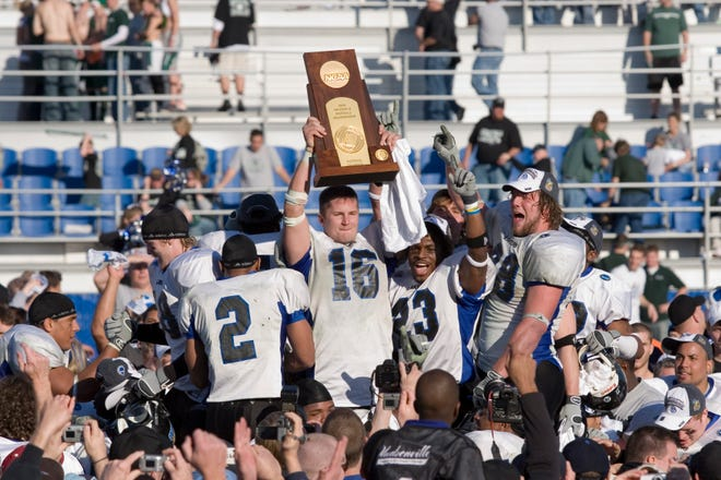Cullen Finnerty hoists the 2006 Division II national-championship trophy.