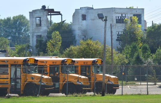 School buses are parked near the former paper mill in the west Michigan city of Parchment. Testing of its water supply in July found 1,587 parts per trillion of PFAS chemicals, far exceeding the 70 ppt health advisory threshold the state adopted this year.