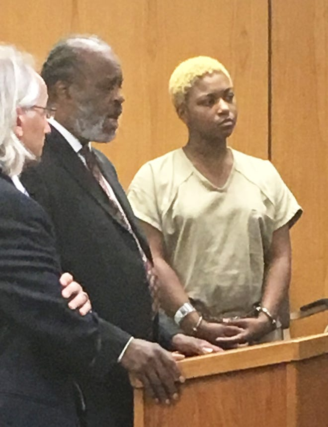 Tanaya Lewis appears in a Warren courtroom for a probable cause conference in September with her attorney, Mark Brown, middle. Assistant Macomb County Prosecutor Bill Cataldo is on the left.