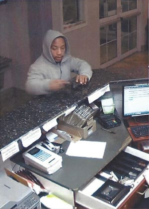 Roseville police are looking for this man who robbed a Microtel lobby early Thursday morning.