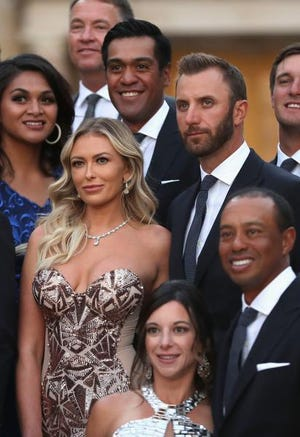 Dustin Johnson, top right, and his partner Paulina Gretzky, and Tiger Woods and his girlfriend Erica Herman before the Ryder Cup Gala dinner.