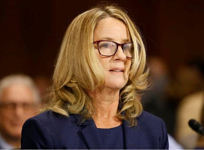 Christine Blasey Ford arrives to testify before the Senate Judiciary Committee on Capitol Hill in Washington, Thursday, Sept. 27, 2018.