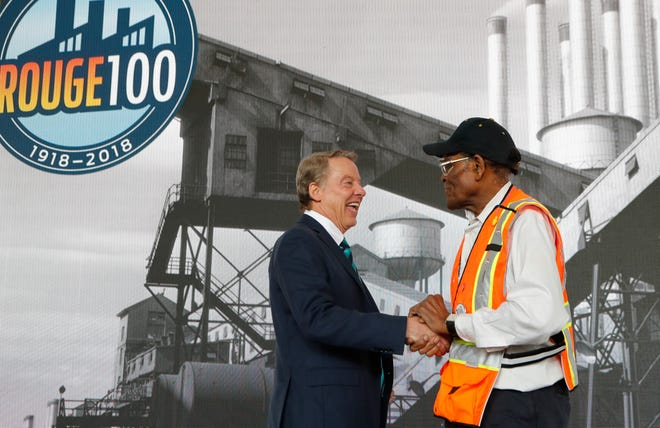 Ford Motor Co.'s executive chairman, Bill Ford Jr., shakes hand will Willie Fulton, a 65-year veteran of the Blue Oval's iconic Rouge complex, celebrating its 100th anniversary.