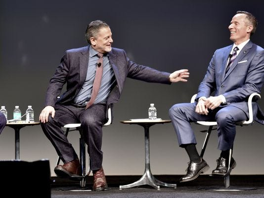 Dan Gilbert, left, and Christopher Ilitch share a laugh at a Detroit forum in May.