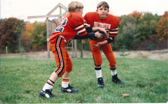 Cullen Finnerty, left, and brother Tim as Pop-Warner players.