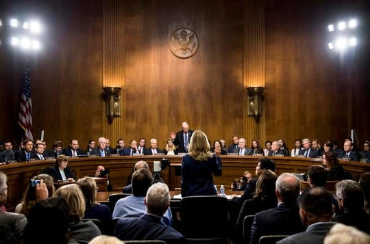 Christine Blasey Ford is sworn in by Senate Judiciary Committee chairman Chuck Grassley, R-Iowa, to testify before the Senate Judiciary Committee on Capitol Hill in Washington, Thursday, Sept. 27, 2018.