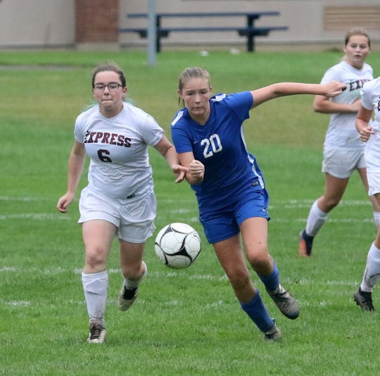 Samanthan Budine (6) of Elmira and Rachel Williams (20) of Horseheads chase after the ball during the Express' 4-0 victory in girls soccer Sept. 27, 2018 at Horseheads High School.