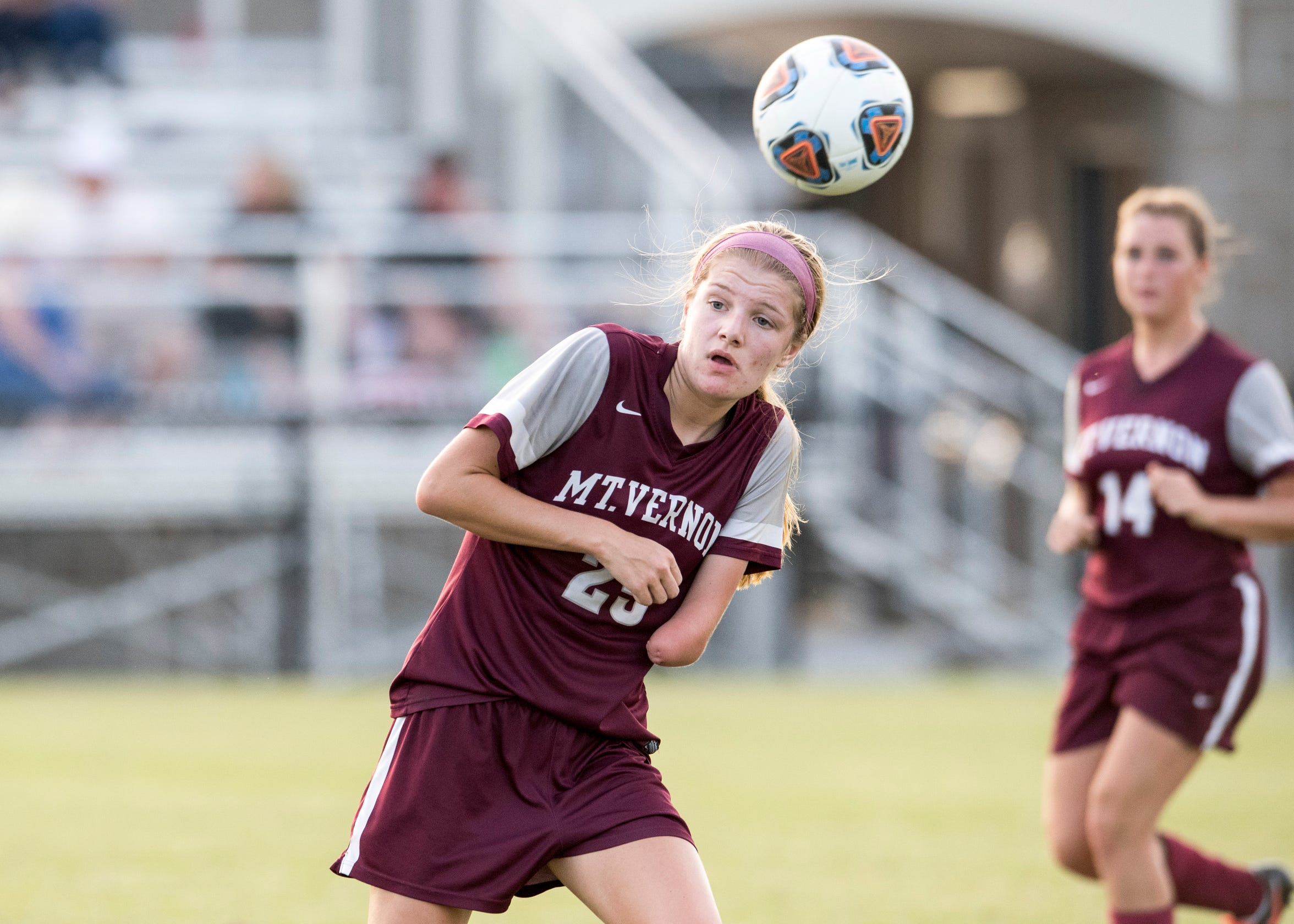 Kenzie Paul, a Junior at Mt. Vernon high school, heads the ball during a game against the Washington Hatchets Sept. 19, 2018.