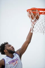 John Hall rolls in a layup during the first official practice of the year at the University of Evansville's Carson Center Thursday morning.