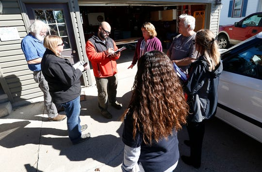 Mark and Dianne Hendricks of Alto talk with members of the Federal Emergency Management Agency and Wisconsin Emergency Management about storm damage to their home.