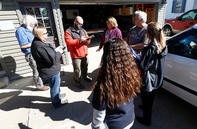 Mark and Dianne Hendricks, of Alto, talk with members of the Federal Emergency Management Agency and Wisconsin Emergency Management about storm damage to their home. From left to right are Dave Sample of the Small Buisness Administration; Jessica Hoffman of WEM; David Laboy of FEMA; Dianne Hendricks; Malyssa Juarez of FEMA; Mark Hendricks; and Bobbi Hicken of WEM.