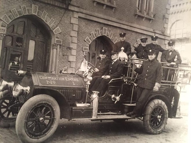 The No. 1 Fire Engine with firefighters aboard.