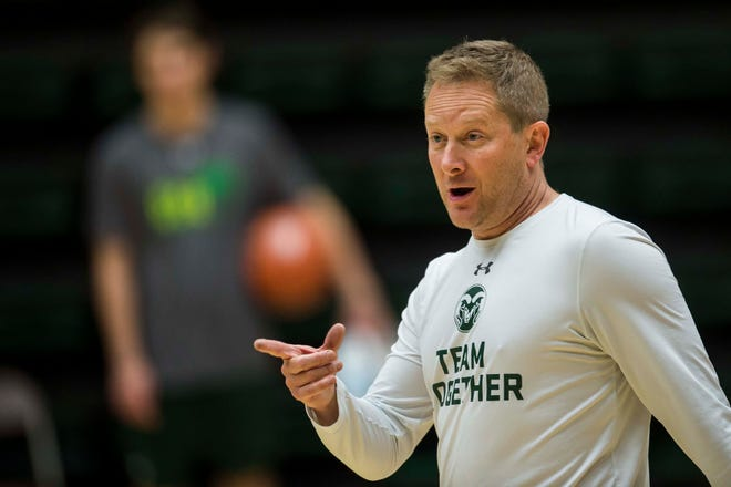 Colorado State University head coach Niko Medved talks to his team during CSU's first practice of the 2018-2019 season on Thursday, Sept. 27, 2018, at Moby Arena in Fort Collins, Colo.