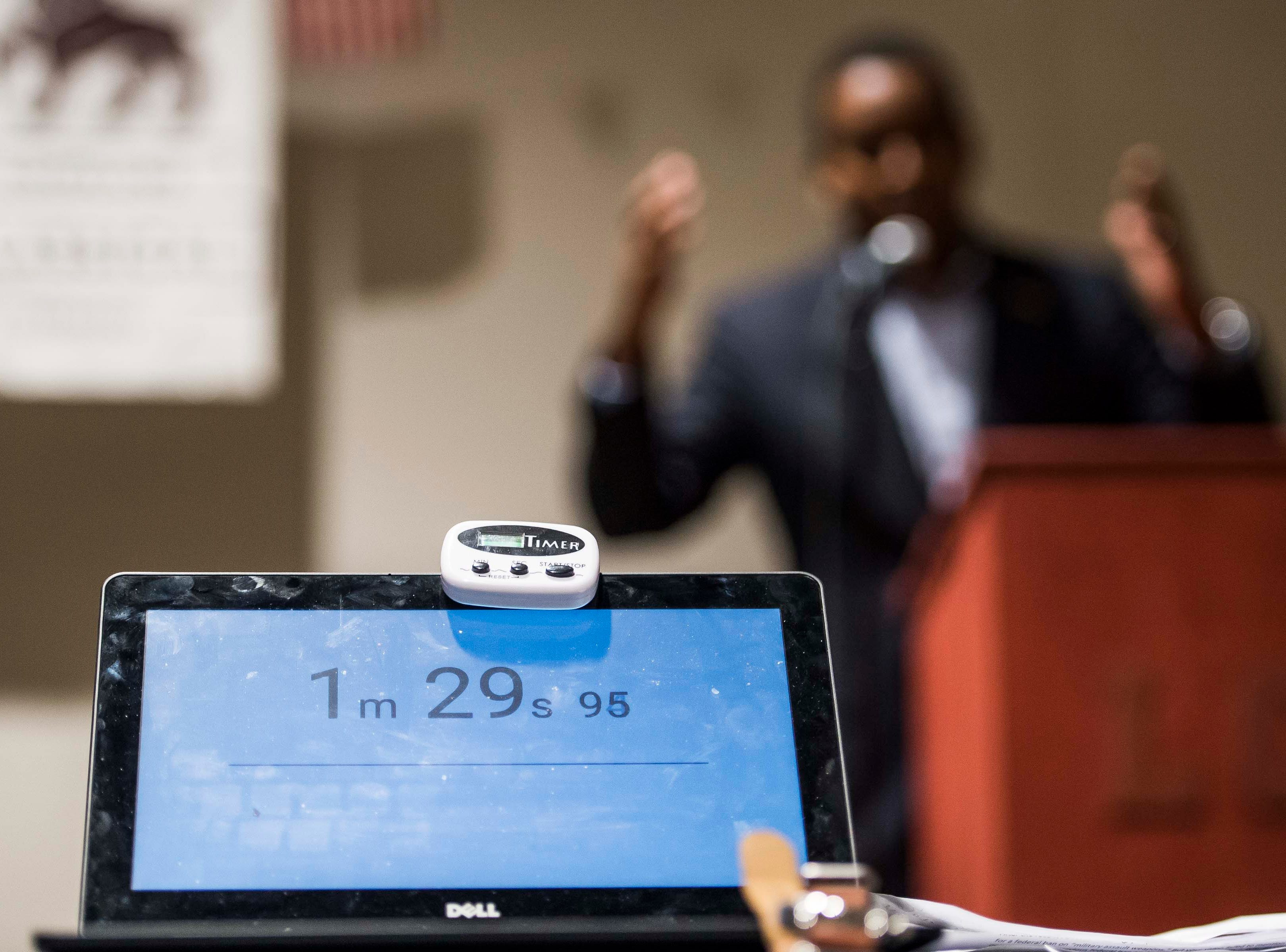 The timer runs as Colorado's 2nd Congressional District Democratic nominee Joe Neguse, right, participates in a debate with Republican nominee Peter Yu on Wednesday, Sept. 26, 2018, at the Loveland Classical Schools in Loveland, Colo.