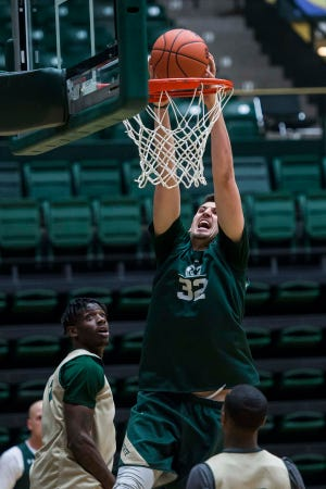 Colorado State University junior center Nico Carvacho (32) dunks during CSU's first practice of the 2018-2019 season on Thursday, Sept. 27, 2018, at Moby Arena in Fort Collins, Colo.