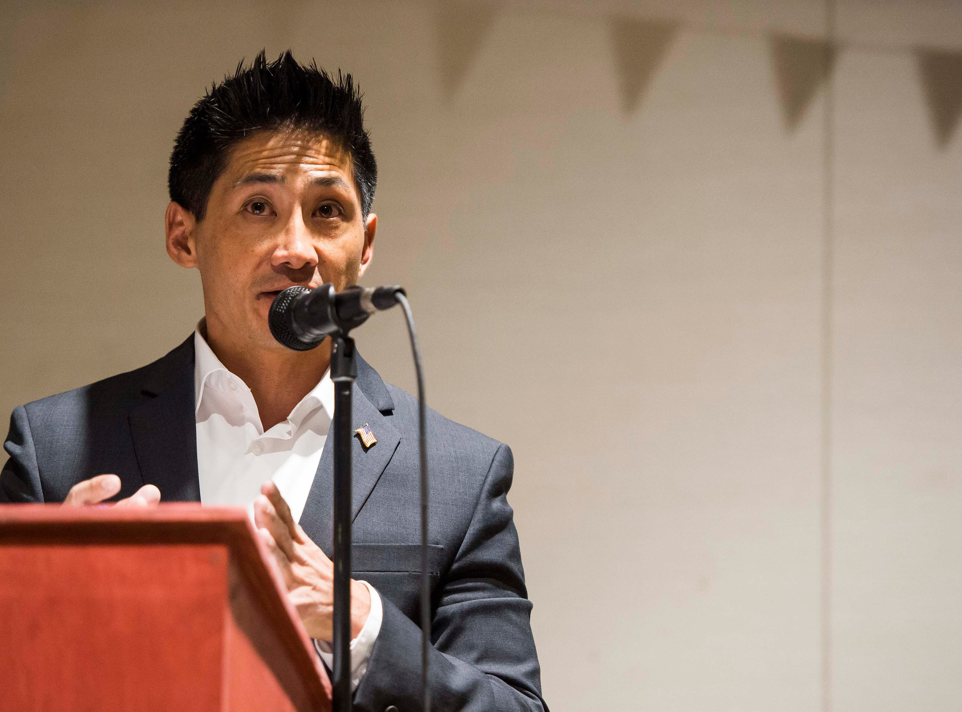Colorado's 2nd Congressional District Republican nominee Peter Yu participates in a debate with Democratic nominee Joe Neguse on Wednesday, Sept. 26, 2018, at the Loveland Classical Schools in Loveland, Colo.