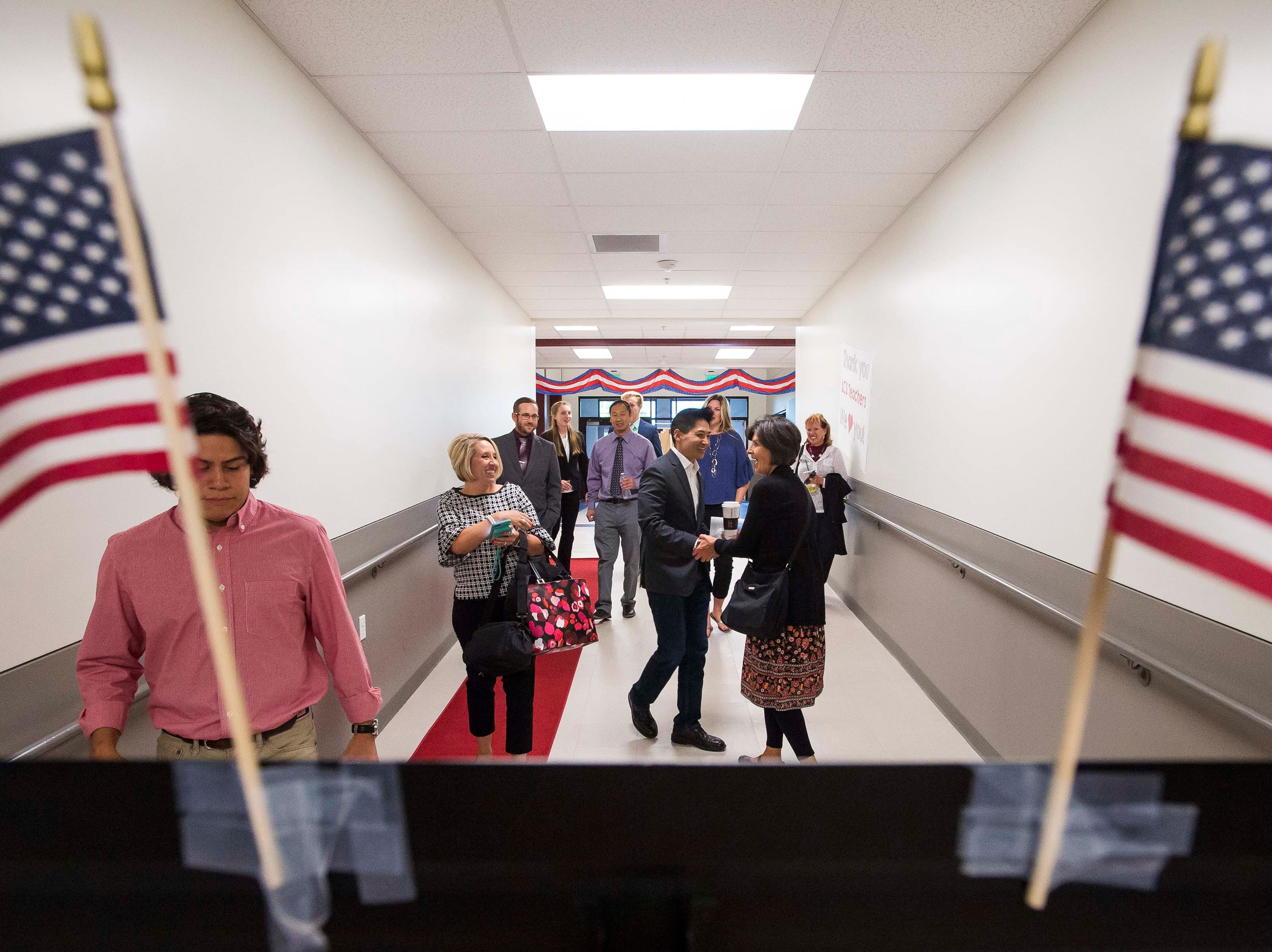 Colorado's 2nd Congressional District Republican nominee Peter Yu shakes hands with an audience member on his way to a debate with Democratic nominee Joe Neguse on Wednesday, Sept. 26, 2018, at the Loveland Classical Schools in Loveland, Colo.