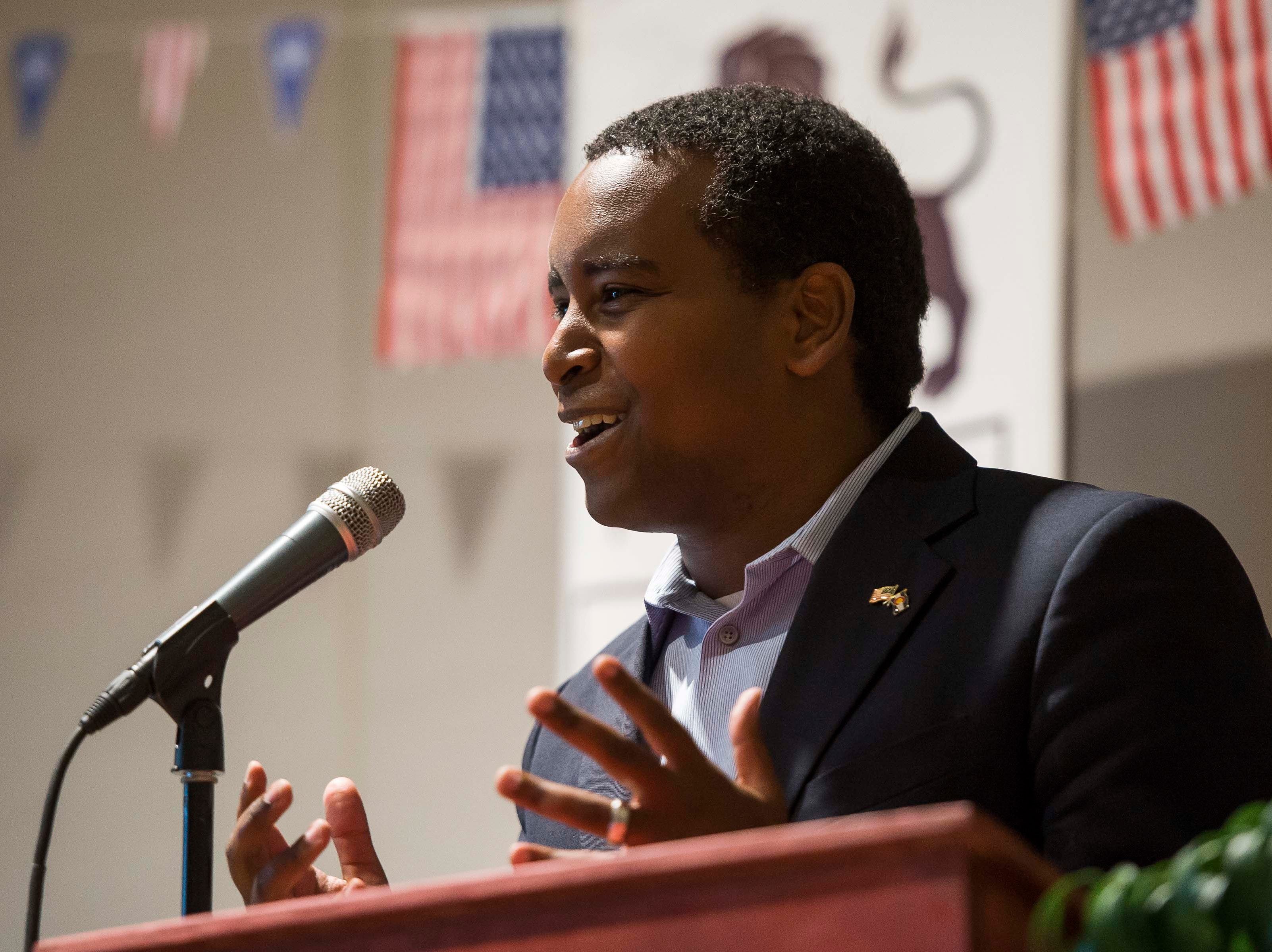 Colorado's 2nd Congressional District Democratic nominee Joe Neguse gives his opening statement before participates in a debate with Republican nominee Peter Yu on Wednesday, Sept. 26, 2018, at the Loveland Classical Schools in Loveland, Colo.