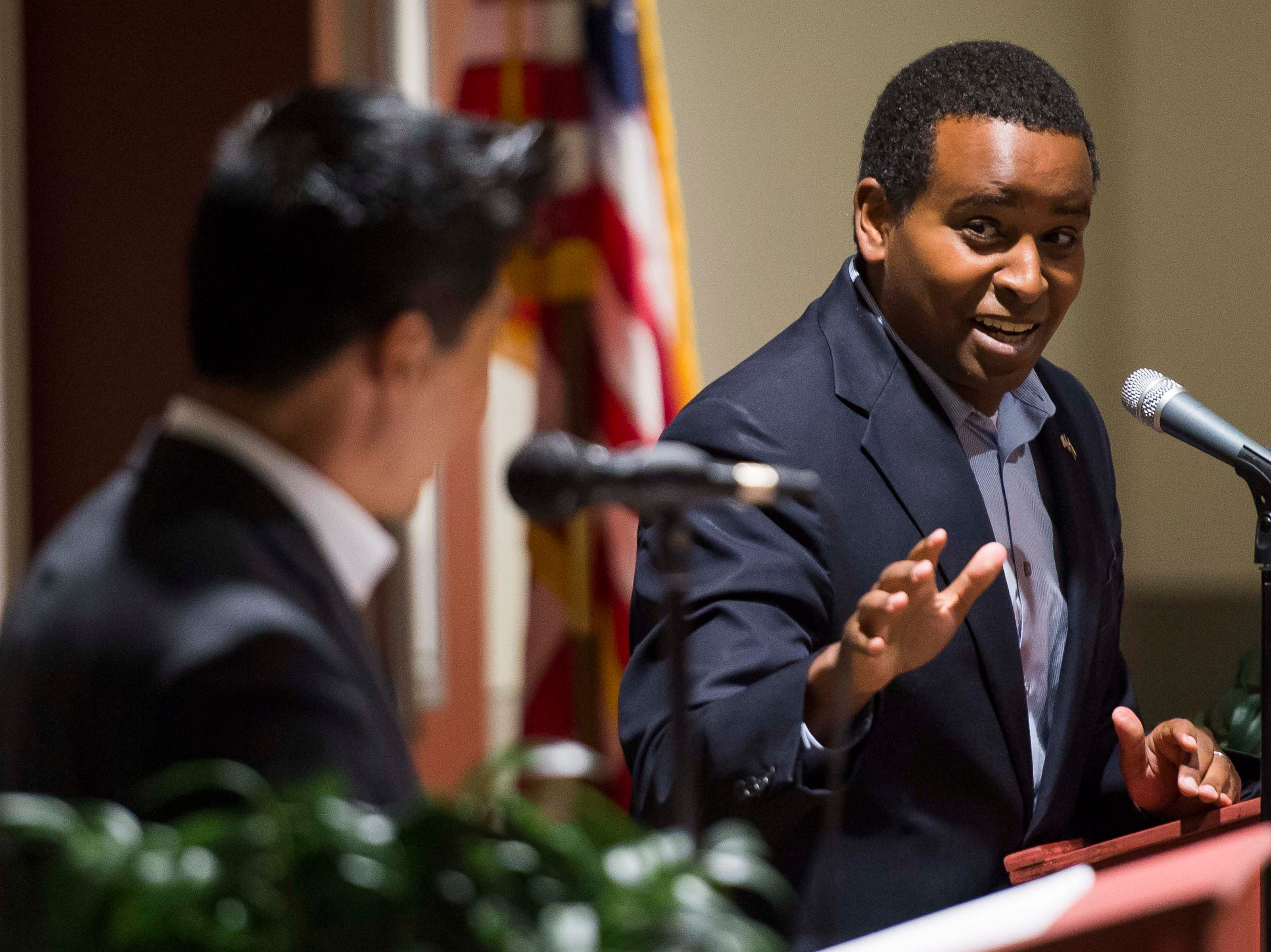 Colorado's 2nd Congressional District Democratic nominee Joe Neguse cross-examines Republican nominee Peter Yu during a debate on Wednesday, Sept. 26, 2018, at the Loveland Classical Schools in Loveland, Colo.