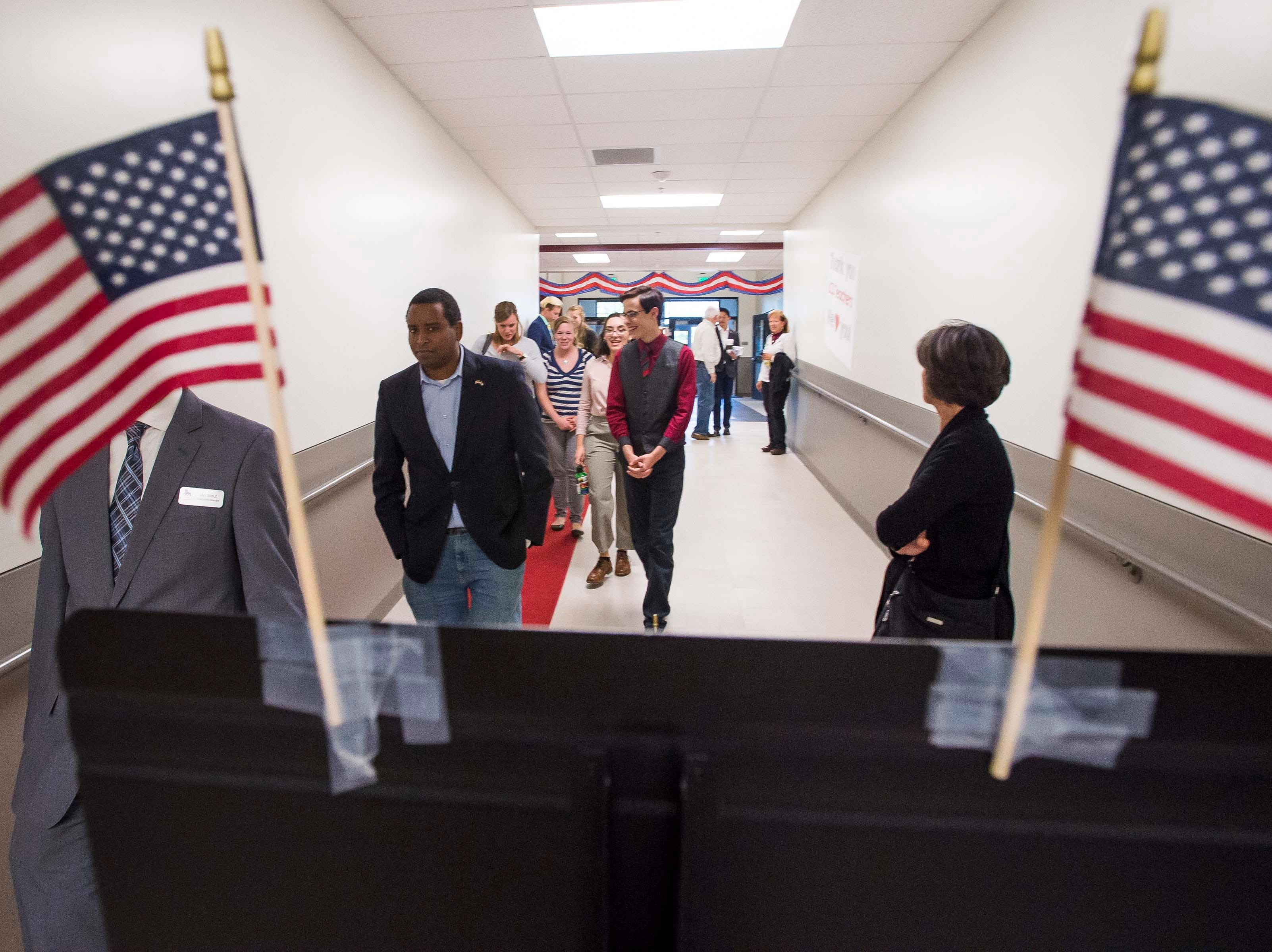 Colorado's 2nd Congressional District Democratic nominee Joe Neguse walks down a hallway on his way to a debate with Republican nominee Peter Yu on Wednesday, Sept. 26, 2018, at the Loveland Classical Schools in Loveland, Colo.