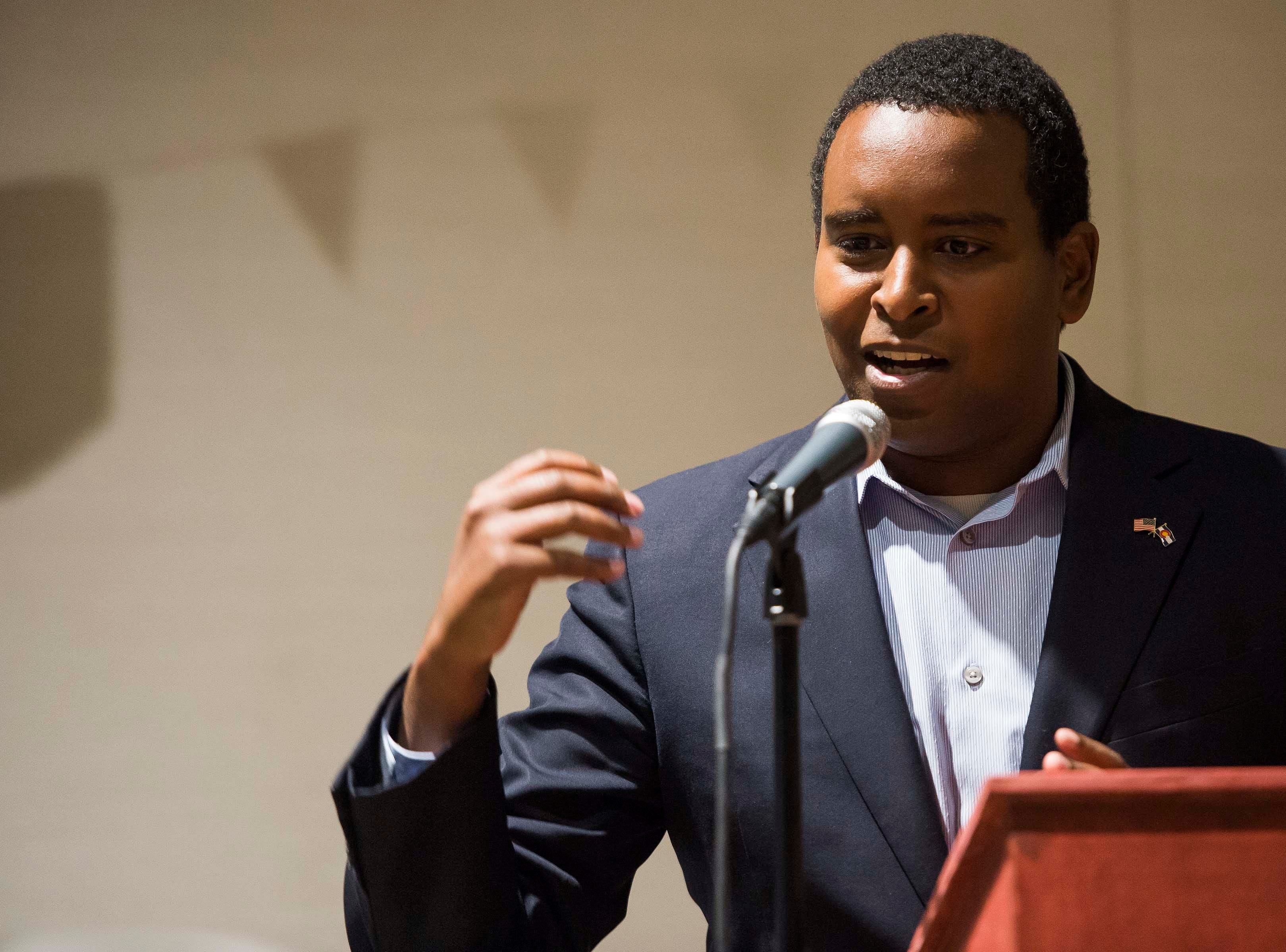 Colorado's 2nd Congressional District Democratic nominee Joe Neguse participates in a debate with Republican nominee Peter Yu on Wednesday, Sept. 26, 2018, at the Loveland Classical Schools in Loveland, Colo.