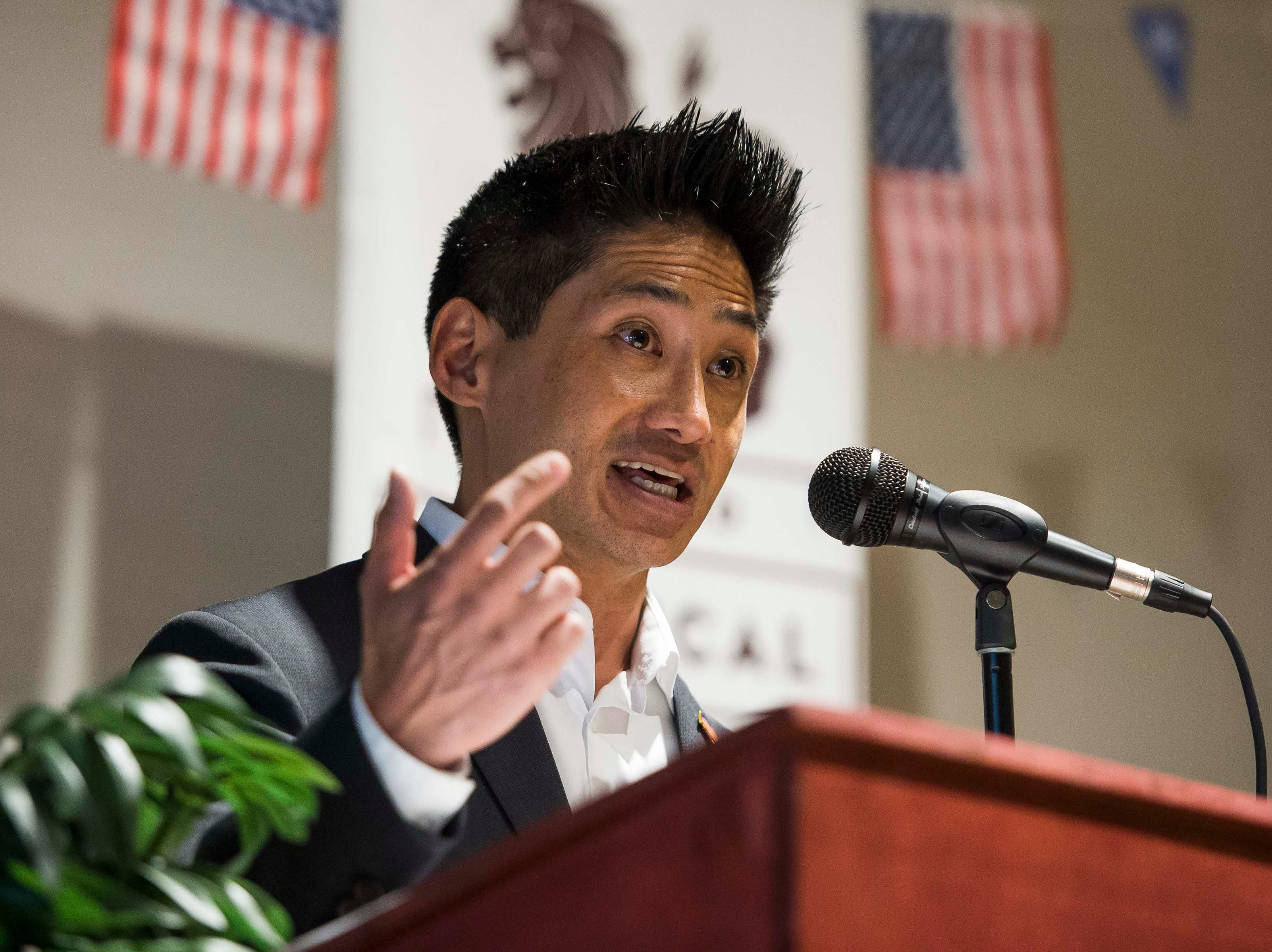 Colorado's 2nd Congressional District Republican Peter Yu gives his opening statement before participated in a debate with Democratic nominee Joe Neguse on Wednesday, Sept. 26, 2018, at the Loveland Classical Schools in Loveland, Colo.