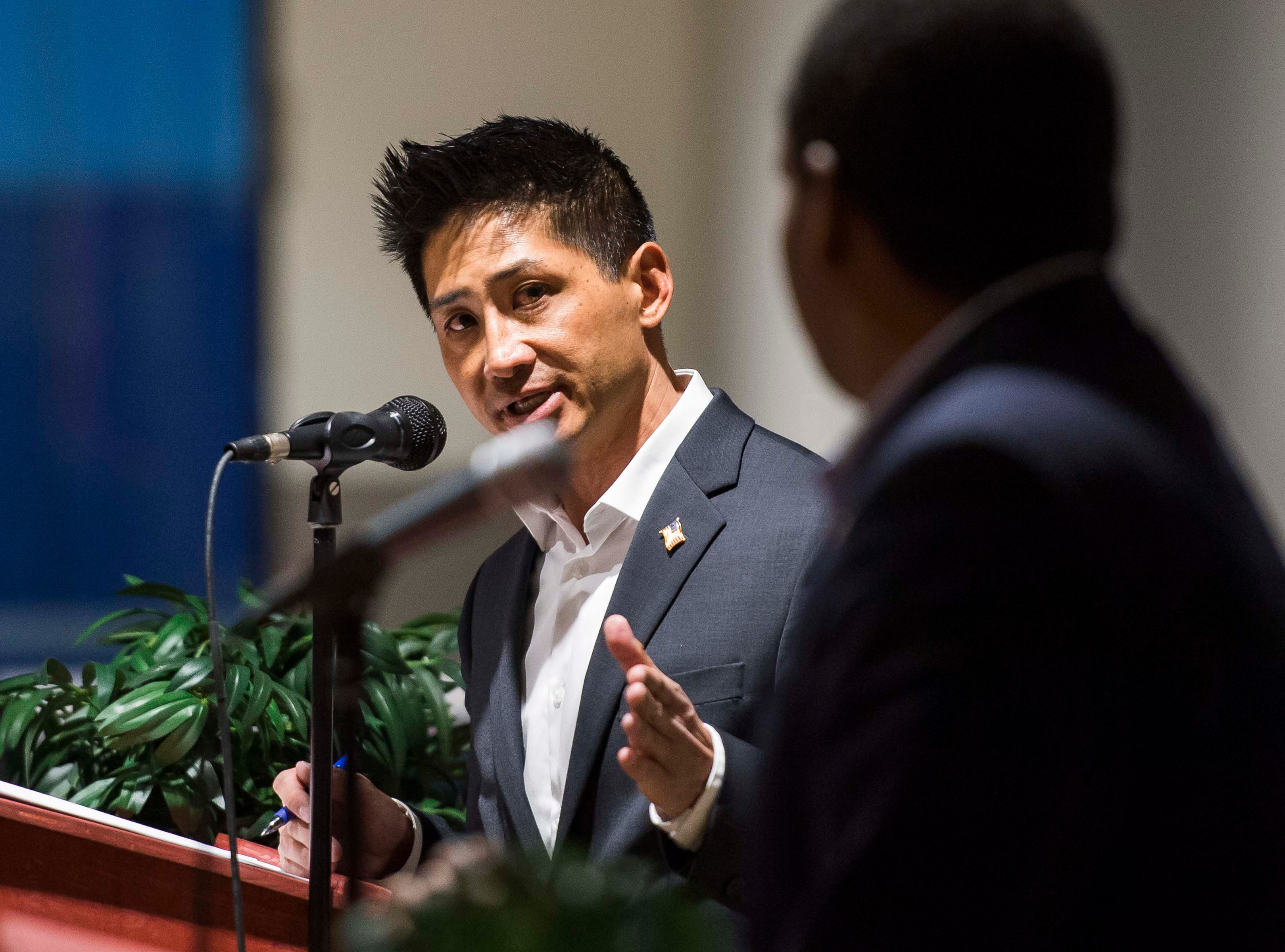 Colorado's 2nd Congressional District Republican nominee Peter Yu cross-examines Democratic nominee Joe Neguse during a debate on Wednesday, Sept. 26, 2018, at the Loveland Classical Schools in Loveland, Colo.