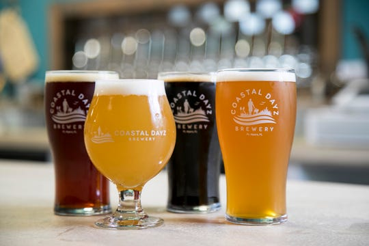 Coastal Dayz Brewery has many types of beer, including blondes, IPAs, pale ales, a honey wheat, an amber, a porter and a stout. Pictured here is the Amberjack Amber Ale, Seas the Day, Pirate's Porter and Bimini Blonde.