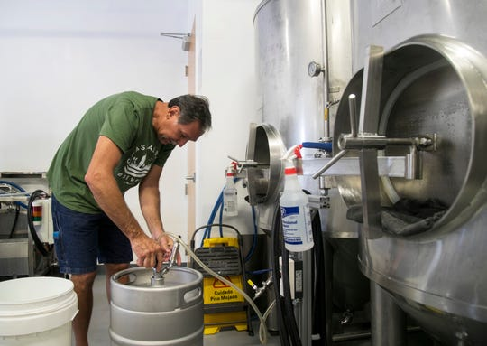 Gary Bethune fills a keg of his Reel Stout at Coastal Dayz Brewery in Fort Myers on Thursday, September 27, 2018.