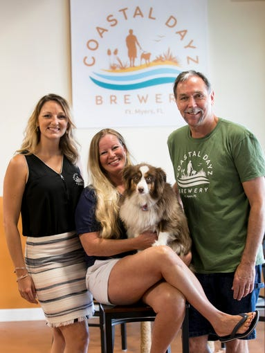 Lisa Bethune, center, and her husband Gary own Coastal Dayz Brewery in Fort Myers and run it with their daughter Alana, left.