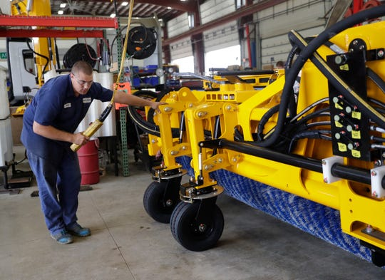 Wesley Immel, testing technician for Wausau Equipment Company, Inc., works on a SnoDozer build Sept. 25, 2018 at the Fond du Lac, Wis.-based airport products facility. Sarah Kloepping/USA TODAY NETWORK-Wisconsin