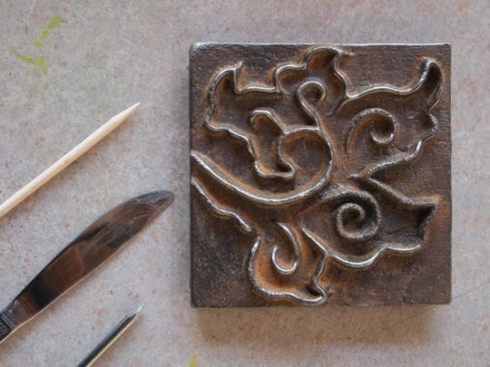 An example of the iron art tiles created at Peninsula School of Art Community Iron Pour.