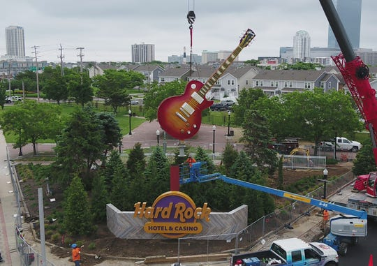 "Jones Sign Company crews install the guitar-shaped sign at the entrance to the Hard Rock Hotel & Casino in Atlantic City, N.J. The sign is one of eight in contention for the title ""Coolest Thing Made in Wisconsin."""