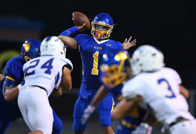 Wren quarterback Tyrell Jackson (1) has passed for 1,747 yards with 25 touchdowns for the undefeated Hurricanes.