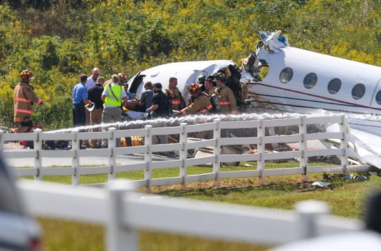 First responders inspect a jet that crashed off a runway, Thursday, Sept. 27, 2018, at the Greenville Downtown Airport.
