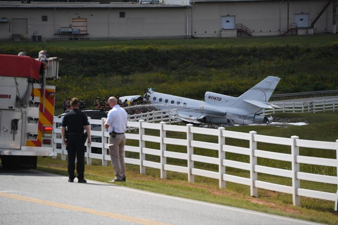 The scene of a plane crash at the Greenville Downtown Airport, Thursday, Sept. 27, 2018.