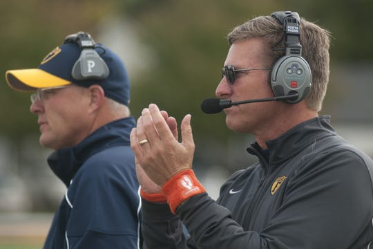 Coach Mike Leonard encourages his players before Franklin College's football game against Anderson, Oct. 19, 2013.