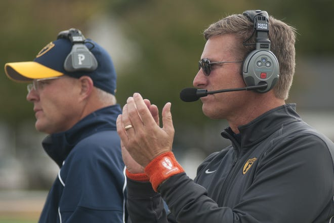 Franklin College football coach Mike Leonard (right) got his 121st win Saturday, breaking the school record for most wins in a career.