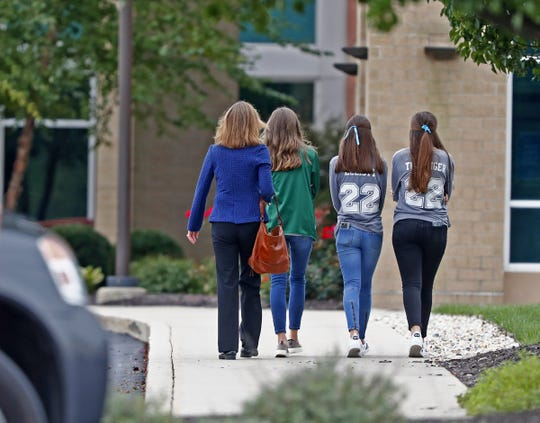 People arrive at Trader's Point Christian Church in Whitestown, Thursday, Sept. 27, 2018, for the visitation and celebration of life for Harrison and Shelby Hunn.  The Zionsville teens were killed in an apparent double murder-suicide Sept. 21, 2018.