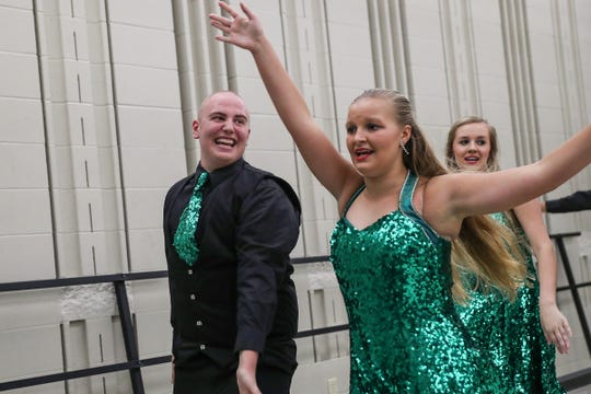 Austin Hewitt warms up for Eastern High School's fall show choir concert in Greentown, Ind., Wednesday, Sept. 26, 2018. In June 2017, Hewitt was declared free of the Ewing sarcoma cancer that led to his toe being amputated. One year later, Ewitt learned the cancer was back in his leg and will soon undergo amputation below the knee.
