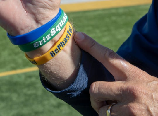Mike Leonard, head football coach for Franklin College, shows off inspirational wrist bands he made for players, and is three wins away from setting the school's record for wins, Franklin, Wednesday, Sept. 26, 2018. Stewart ÒRedÓ Faught currently holds the record for wins with 120.