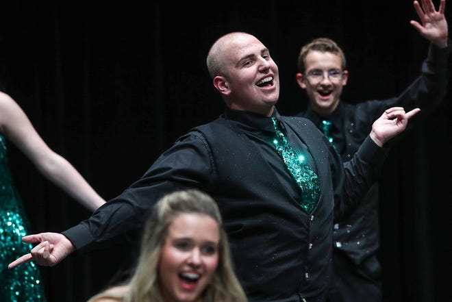 Senior student Austin Hewitt warms up before Eastern High School's fall show choir concert in Greentown, Ind., Wednesday, Sept. 26, 2018. In October, Hewitt will undergo amputation of one leg below the knee, a result of his second battle with Ewing sarcoma bone cancer.