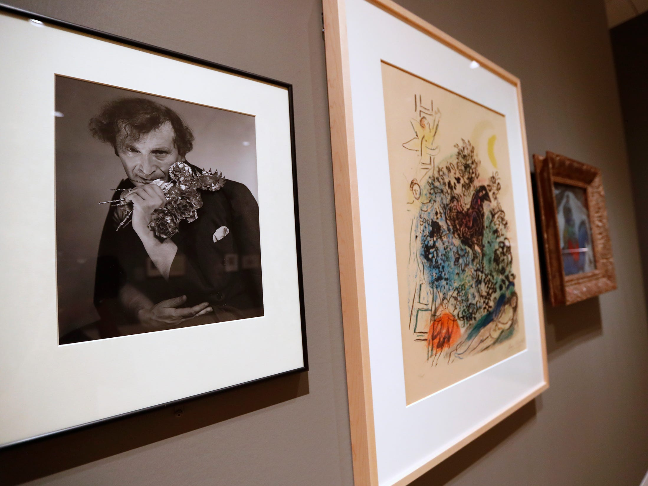 "This undated portrait of artist Marc Chagall, by George Platt Lynes, is exhibited with Chagall's 1961 color lithograph called ""Lover's Dream,"" and his 1943-44 oil on canvas called, ""The Flight into Egypt,"" seen at the George Platt Lynes exhibit at Newfields, Wednesday, Sept. 26, 2018.  The photograph is from the Collections of the Kinsey Institute, Indiana University; a gift of Gene L. and Jane E. Rench Prather.  Lynes gained fame as a commercial and ballet photographer in the 1930s and 1940s, but he wanted to be known for the male nudes he captured of the male ballet dancers and others.  The exhibit runs Sept. 30, 2018 through Feb. 24, 2019."