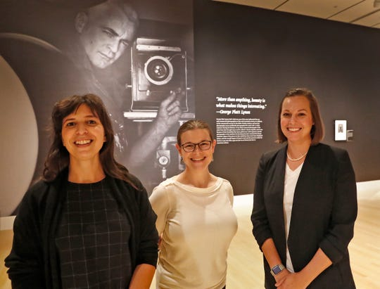 "Rebecca Fasman, from left, Anne Young, and Robin Lawrence, curators of the ""Sensual / Sexual / Social:  The Photography of George Platt Lynes"" exhibit at Newfields, pose in front of a Lynes self-portrait, Wednesday, Sept. 26, 2018. The 1952 gelatin silver print is from the Collections of the Kinsey Institute, Indiana University.  Lynes gained fame as a commercial and ballet photographer in the 1930s and 1940s, but he wanted to be known for the male nudes he captured of the male ballet dancers and others.  The exhibit runs Sept. 30, 2018 through Feb. 24, 2019."