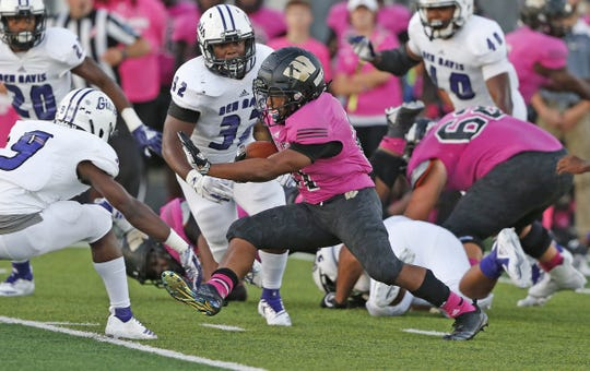 Warren Central's Romeir Elliott weaves in between Ben Davis defense in the first half of the game at Warren Central High School in Indianapolis, Ind., Friday, Sept. 7, 2018. Warren Central defeated Ben Davis 70-27.