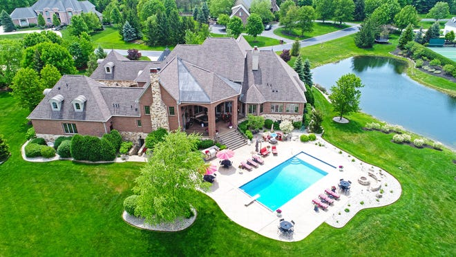The 13,848 square-foot estate sits on three acres in a gated community in an area known for its celebrity residents. It offers private access to Geist Reservoir.