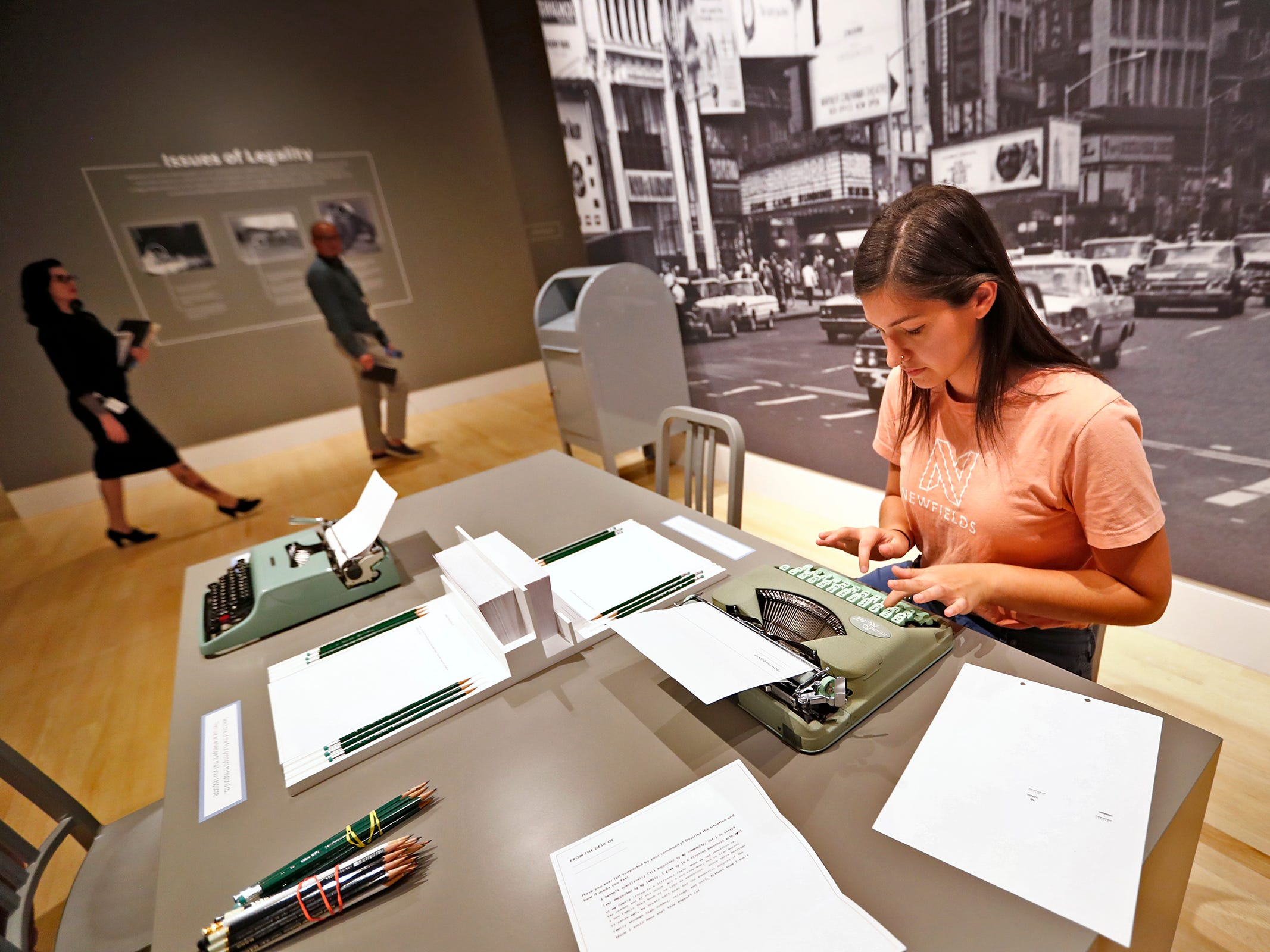 Interpretation Planner Wednesday Rees types a letter in an interactive part of the George Platt Lynes exhibit at Newfields, Wednesday, Sept. 26, 2018.  The letters, some to be displayed, allow the exhibit viewers to add their thoughts and experiences to certain offered questions. Lynes gained fame as a commercial and ballet photographer in the 1930s and 1940s, but he wanted to be known for the male nudes he captured of the male ballet dancers and others.  The exhibit runs Sept. 30, 2018 through Feb. 24, 2019.