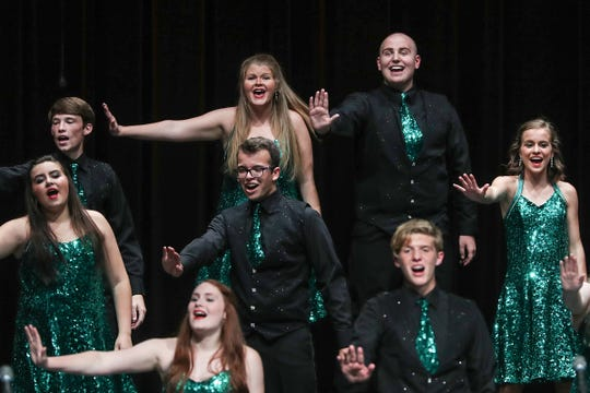 Top right, senior student Austin Hewitt performs in Eastern High School's fall show choir concert in Greentown, Ind., Wednesday, Sept. 26, 2018. In October, Hewitt will undergo amputation of one leg below the knee, a result of his second battle with Ewing sarcoma bone cancer.