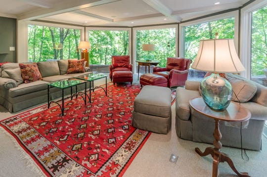 A wall of windows in the family room offers expansive views of the wooded property.