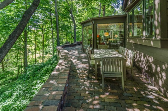 The 2.7-acre northside property is nestled in the woods. It's listed for $649,999.